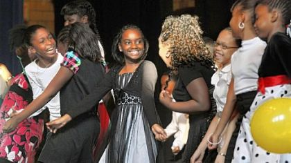 DaMesha Carpenter and other fifth-graders have fun as they perform during the Pittsburgh Dancing Classroom show at Pittsburgh Allegheny K-5 school.