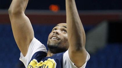 West Virginia's Da'Sean Butler shoots during practice.
