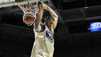 Pitt's Gilbert Brown dunks the ball as his team practices.