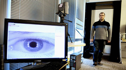 Ramzi Abiantun demonstrates the long-range iris-scanning technology being developed at Carnegie Mellon University's CyLab Biometrics Center. The machine can scan and identify a person from his iris up to 15 meters away.