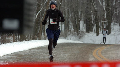 Jacob Morrida, of Clinton, wins the Frigid 5-Miler at North Park.