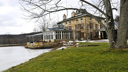 An outside view of the 11,000-square-foot Riverstone Estate mansion with the south pond.