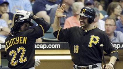 The Pirates' Andrew McCutchen is congratulated by Neil Walker after McCutchen hit a home run during the fifth inning.