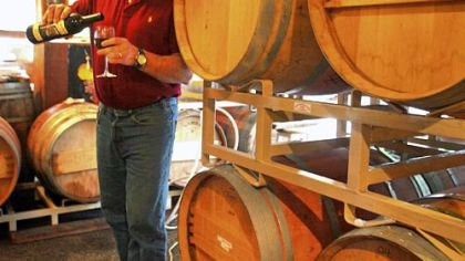 Jim Wilford, owner of Fletcher Bay winery on Bainbridge Island, pours a glass of red wine. He makes his wines using grapes from Columbia Valley, Walla Walla and the Yakima Valley.