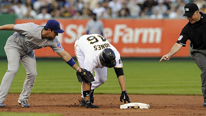 The Pirates&#039; Garrett Jones gets into second base safely as he&#039;s tagged by Cubs shortstop Ryan Theriot in the third inning.