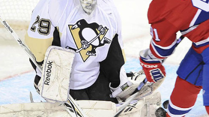 Penguins goaltender Marc-Andre Fleury makes a save on Canadiens forward Scott Gomez during Tuesday&#039;s game at the Bell Centre in Montreal.