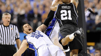 Butler's Willie Veasley drives to the net against Duke's Brian Zoubek in the first half.