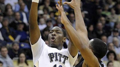 Pitt's Ashton Gibbs puts up a three-point shot against Providence's Sharaud Curry in the first half of Thursday's game at the Petersen Events Center.