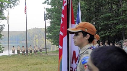 Boy Scouts from Camp Liberty gather for the flag-lowering ceremony.