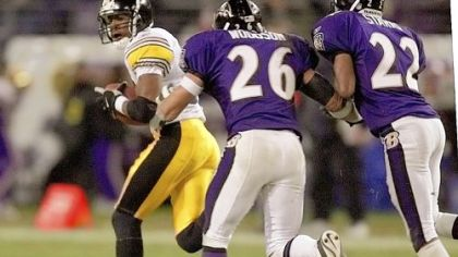 Pittsburgh Steelers wide receiver Bobby Shaw looks back toward Baltimore Ravens safety (and former Steeler legend) Rod Woodson (26) and cornerback Duane Starks after catching a 90-yard touchdown pass from quarterback Kordell Stewart in the fourth quarter in Baltimore, Sunday, Dec. 16, 2001. The Steelers won 26-21.
