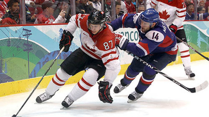 Sidney Crosby controls the puck in front of Slovakia defenseman Andrej Meszaros Friday night.
