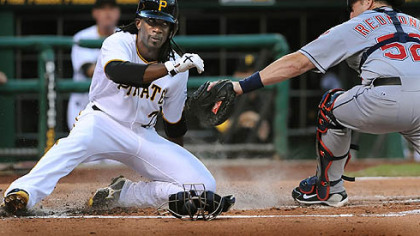 Andrew McCutchen slides past Cleveland catcher Mike Raymond to score in the third inning Saturday at PNC Park.