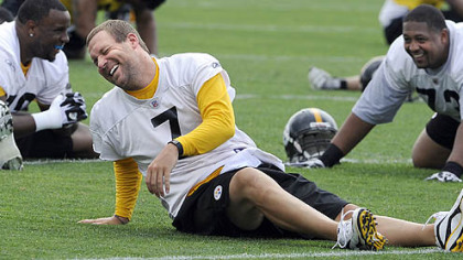 Steelers quarterback Ben Roethlisberger stretches during his first day back to spring practice at the team's South Side facility today.