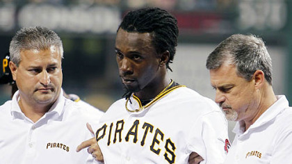 The Pirates&#039; Andrew McCutchen is helped off the field by trainers Brad Henderson, right, and Mike Sandoval, left, during the second inning.