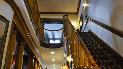 The first floor opens to a grand entry hall and its tiger-wood maple staircase that is open to all three floors. The spiral staircase leads to a fourth-floor widow's walk and cupola.