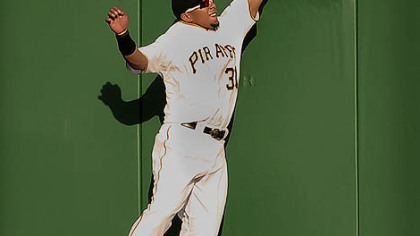Pirates center fielder Jose Tabata climbs the wall but can not make a catch on ball hit by the Brewers Rickie Weeks.