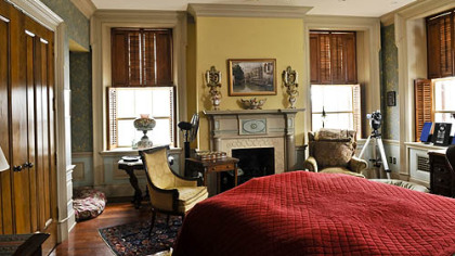 The second-floor master bedroom is fashioned from three rooms. It has painted woodwork, a cherry floor and natural slate hearths, as well as an English coal basket fireplace inserts.