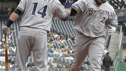 The Brewers' Prince Fielder is greeted by Casey McGehee after his solo home run in the second inning.