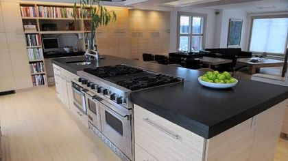 "The kitchen is part of the first floor's open ""flex"" space that has room to seat up to 30 people for dinner."