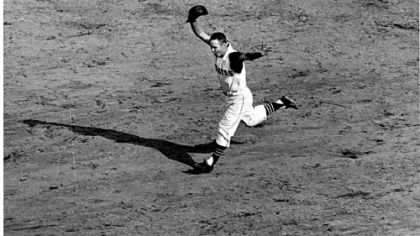 This 1960 photo of Bill Mazeroski rounding second base after his famous home run will serve as the model for the new PNC Park statue.