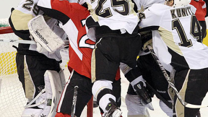 Max Talbot jumps on Ottawa&#039;s Chris Neil in a scrum in front of Marc-Andre Fleury in the first period Tuesday night in Game 4 in Ottawa.