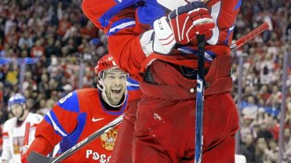 Pavel Datsyuk watches as Alexander Ovechkin congratulates Evgeni Malkin after Malkin scored a goal for Russia in the first period of Sunday's preliminary round game against the Czech Republic.