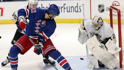 Penguins goaltender Marc-Andre Fleury and defenseman Sergei Gonchar defend the net against Rangers forward Artem Anisimov during the second period.
