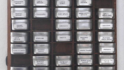 Melissa Kronenthal&#039;s spice rack is built from an antique printer&#039;s tray and metal tins.