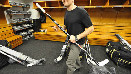 Sergei Gonchar heads for the locker room door Friday after packing up his gear at Mellon Arena. With Gonchar a free agent, will it be for the last time?
