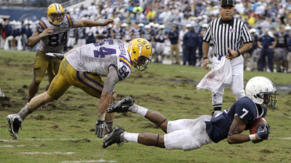 Penn State wide receiver Curtis Drake hauls in a pass in front of LSU linebacker Jacob Cutrera.