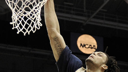 Pitt's Gary McGhee dunks the ball as his team practices.