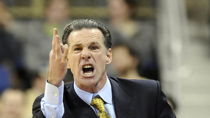Pitt head coach Jamie Dixon complains to a referee in the first half.
