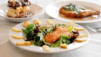 Gary Komoroski's dishes at Scoglio's in Green Tree include warm pear salad with salmon and gorgonzola cheese, front; homemade profiteroles with vanilla ice cream, toasted almonds and chocolate fudge sauce, left; and a pork chop with panko crumbs with fresh spinach, Bel Paese cheese and lemon white wine with veal stock.