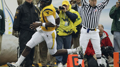 West Virginia quarterback Jarrett Brown scores a first-quarter touchdown against Florida State.