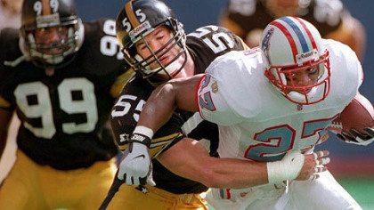 Former Steelers linebacker Jerry Olsavsky tackles former Houston Oilers running back Eddie George in 1996 at Three Rivers Stadium. Olsavsky was hired by the Steelers as linebackers coach.