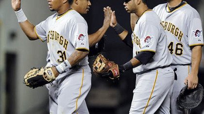 The Pirates' Jose Tabata, Octavio Dotel, Pedro Alvarez and Garrett Jones, from left, congratulate each other after beating the Rockies, 4-2, Tuesday at Coors Field.