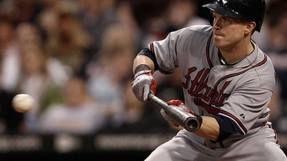 The Braves demoted former Pirates outfielder Nate McLouth to Class AAA Gwinnett.