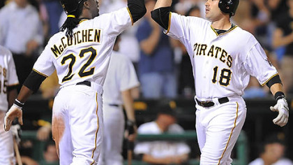 The Pirates' Neil Walker is greeted at home by Andrew McCutchen after Walker's two-run home run in the eighth inning Tuesday at PNC Park.
