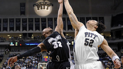 Pitt's Gary McGhee and Providence's Vincent Council go for a rebound in the first half.