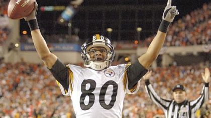 Cedric Wilson celebrates after scoring in the third quarter on a trick play in a 2005 Wild Card win over  the Bengals.