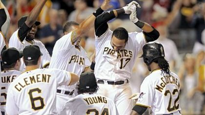 Pedro Alvarez (17) is congratulated after his walkoff home run in the 10th inning Saturday at PNC Park.