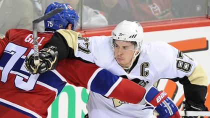 Penguins forward Sidney Crosby battles with Canadiens defenseman Hal Gill during Tuesday's Game 3 in the Bell Centre in Montreal.