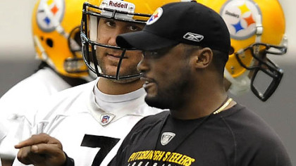 Steelers quarterback Ben Roethlisberger listens to head coach Mike Tomlin during Wednesday's practice at the team's facility on the South Side.