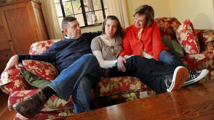 Russell and Robalee Bruesewitz sit with their 18-year-old daughter Hannah, center, at their home on Lebanon Avenue in Mt. Lebanon on Monday.  The U.S. Supreme Court will hear a case brought by the Bruesewitzs on Hannah's behalf.