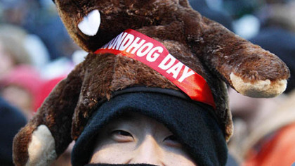 Charles Lim, of New York City, braves the weather on Gobbler's Knob to watch Punxsutawney Phil.