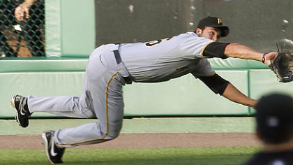 Pirates right fielder Garrett Jones makes a diving catch to rob the Nationals' Adam Dunn in the first inning Thursday at Nationals Park.