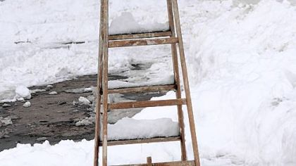 A ladder is used to mark a parking spot on Wightman near Bartlett in Squirrel Hill.