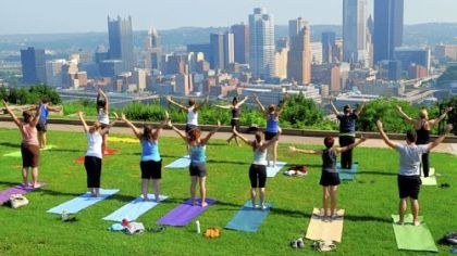 Lori Grabel teaches Breathe Yoga's outdoor class in Mt. Washington's Grandview Park overlooking Downtown Pittsburgh