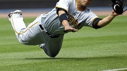 Pirates right fielder Delwyn Young makes a diving catch to retire the Braves' Troy Glaus in the seventh inning Sunday at Turner Field.