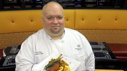 Share Wine Lounge & Small Plates Bistro executive chef Chris Jones with the Tuscan Chop -- an oven-roasted pork chop with garlic cloves, rosemary, fingerling potatoes and market vegetables.